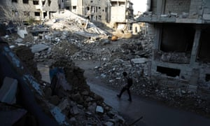 A street damaged by shelling on the outskirts of Damascus