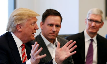 Peter Thiel (center) with Apple CEO Tim Cook at a summit of technology leaders with Donald Trump in December 2016.
