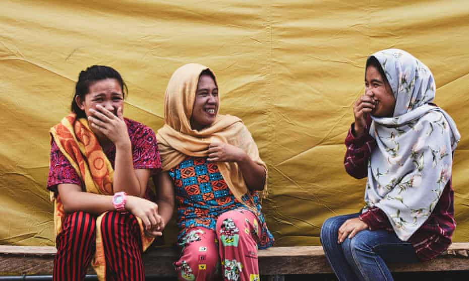 Nor-Ain Ibrahem, 25, (centre) sits with her friends Ashlia Mandangan, 17, (left) and Aenesah Capal, 19 (right) in Landar evacuation centre. All three have been attending the WFS for three months.