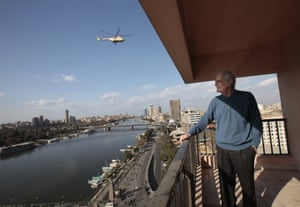 Sharif looks over Cairo as an Egyptian army helicopter monitors protesters gathered in Tahrir Square, 2011