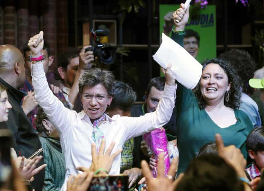 Claudia López, left, celebrates her mayoral victory in Bogotá on 27 October with her partner Angélica Lozano.