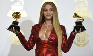 Beyoncé poses with the awards for best music video and best urban contemporary album at the Grammys.
