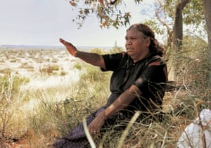 Australian Indigenous artist Kwementyaye 'Kathleen' Petyarre looking across Atnangker country, Northern Territory, in December 2000.