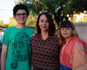 Santi Ceballos, right, stands with mom Carol Brochin and brother Joaquin Ceballos outside their home in Tucson, Arizona.