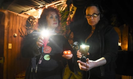 Jenny Thomas and Brigid Goode, part of a group that claims to be one of the country's first-ever all-female team of 'paranormal investigators, use their ghost hunting gear.