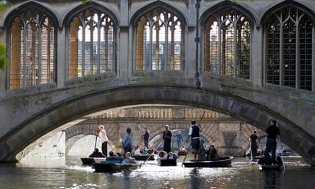 People are seen punting on the River Cam near the Bridge of Sighs at St John's College in Cambridge