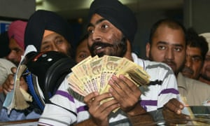 Customers at a bank in Amritsar. Many Indians were left without cash for their daily expenses.