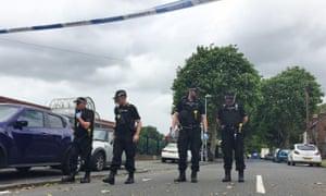Police search the scene in Erdington where James Teer was shot dead on Thursday.