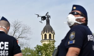 Police officers in Szolnok, Hungary, use a drone to find residents failing to comply with the stay-at-home order