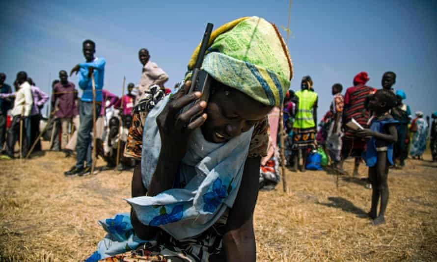 South Sudan, woman uses phone.