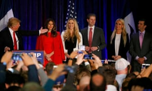 Republican Presidential Candidate Donald Trump speaks with his family onstage at caucus night rally in Des Moines, Iowa/