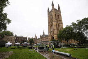 Workers erect scaffolding for television studios outside the Houses of Parliament today.
