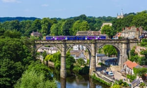Northern Rail train on the viaduct over the River Nidd, Knaresborough, North Yorkshire. 'The real competition with rail comes from air and road transport,' writes Les Summers.