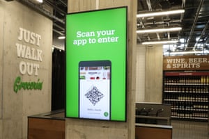 A sign at the new Amazon Go Grocery store in Seattle tells customers how to begin shopping.