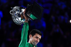 Djokovic poses with the Norman Brooks Challenge Cup trophy following his victory.