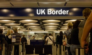 Newly-arrived airline passengers at Heathrow airport.