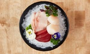 'Laid prettily across shredded mooli ': mixed sashimi.