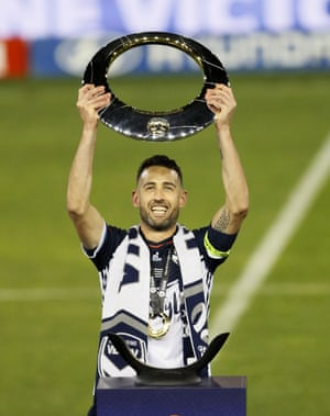 Carl Valeri of the Victory holds the trophy after the A-League Grand Final between the Newcastle Jets and Melbourne Victory.