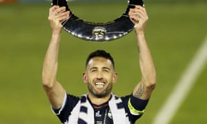 Carl Valeri with the A-League's champions' trophy