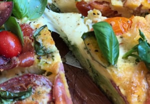 A close up of the caprese salad frittata being cut