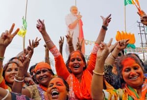 Supporters of India's ruling BJP celebrate state election results in Agartala in March.