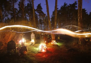 Belarus: Catholics marked All Saints Day by taking candles to visit the graves of their relatives at a cemetery in the town of Rakov. (A long exposure photo)
