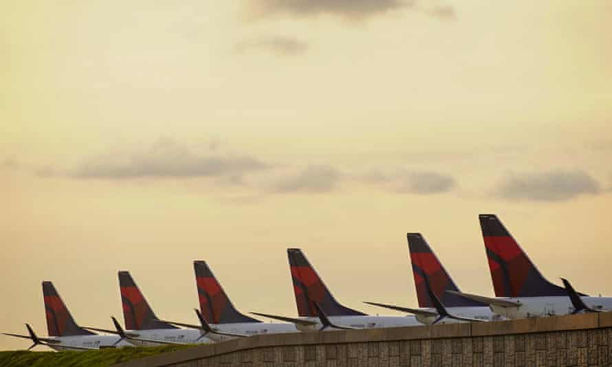 Delta planes lined up on a runway where they are parked due to flight reductions made to slow the spread of coronavirus at Atlanta Hartsfield-Jackson international airport.
