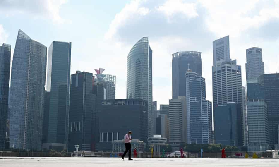 A man walks along the promenade at Marina Bay in Singapore