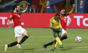 South Africa's Thembinkosi Lorch slams home the ball to open the scoring in the dying minutes.