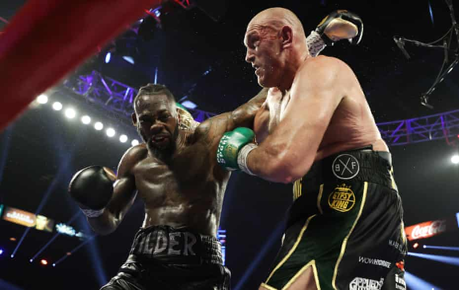 Tyson Fury and Deontay Wilder trade blows during their bout for Wilder's WBC and Fury's lineal heavyweight title in February 2020.