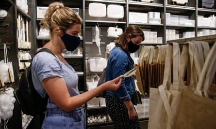 Shoppers wear face masks in London.