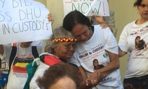 Ms Dhu's grandmother, Carol, and daughter, Della, break down when a song written in her memory is played at a demonstration outside Perth magistrates court.