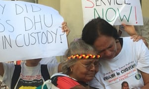 Ms Dhu's grandmother, Carol, and daughter, Della, break down when a song written in her memory is played at a demonstration outside Perth Magistrates Court on Monday 14 March 2016.