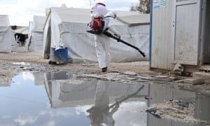 Volunteers from 'Violet Organization', a local non government organization, wear personal protective equipment and use equipments during a disinfection operation in Idlib, Syria, 09 April 2020 EPA/YAHYA NEMAH