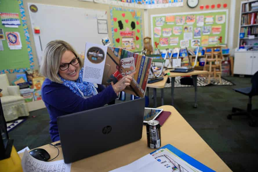 Joanne Collins Brock, a teacher at a school in Goshen, Kentucky, has been holding online lessons daily in her empty classroom.