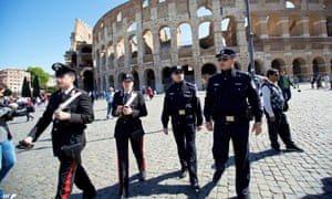 Chinese and Italian police patrol outside the Colosseum in Rome