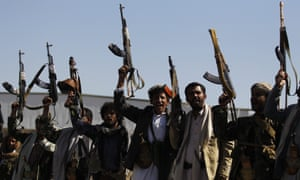 Armed tribesmen in Yemen show their support for the Houthi rebels on the eve of peace talks in Geneva.