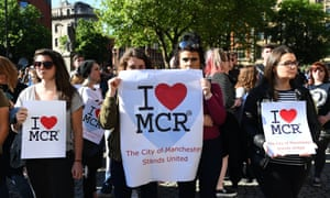 People attend a vigil for those who lost their lives during the Manchester terror attack