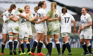 Emily Scarratt is congratulated by Poppy Cleall after kicking England's winning penalty against France.