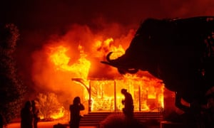 The Soda Rock Winery burns during the Kincade fire as flames race through Healdsburg, California on Sunday.