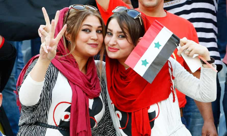 Syrian fans at the Azadi stadium in Tehran, where Iranian women were barred from the match.