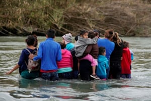 Migrants cross the Rio Bravo