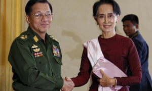 Myanmar's commander-in-chief, Min Aung Hlaing, shakes hands with Aung San Suu Kyi in 2015
