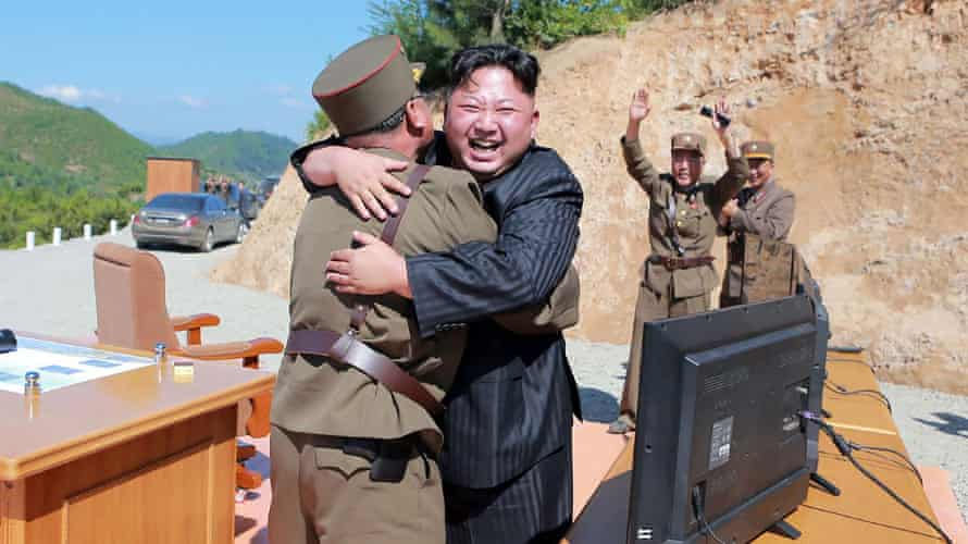The North Korean leader Kim Jong-un celebrates the successful test of the Hwasong-14 missile.