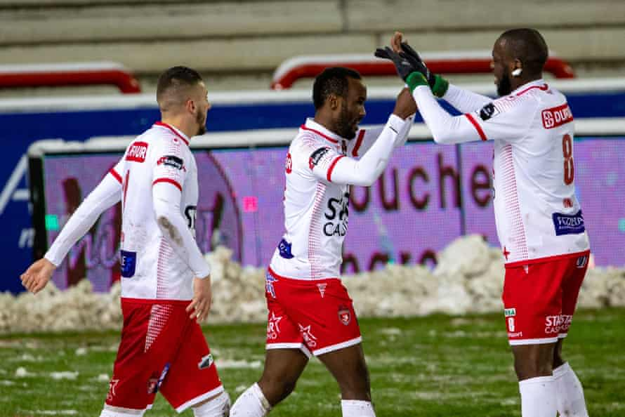Fabrice Olinga celebrates after scoring for Mouscron against Genk. Mouscron has been owned by four different people since Olinga joined in 2015