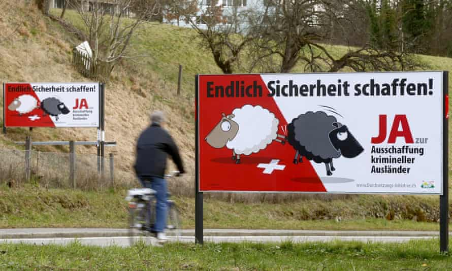 """Swiss People's party posters call on citizens to vote in favour of deporting foreign nationals for minor crimes. It reads """"At last make things safer! Say yes to deportation of criminal foreigners""""."""