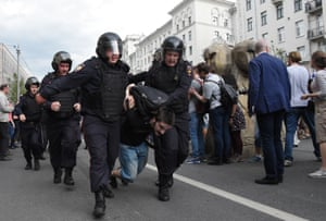 Police drag a protester away from an unauthorised rally in central Moscow