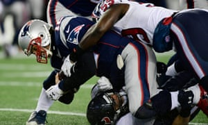 Tom Brady is sacked by Houston Texans Whitney Mercilus and Brian Cushing.