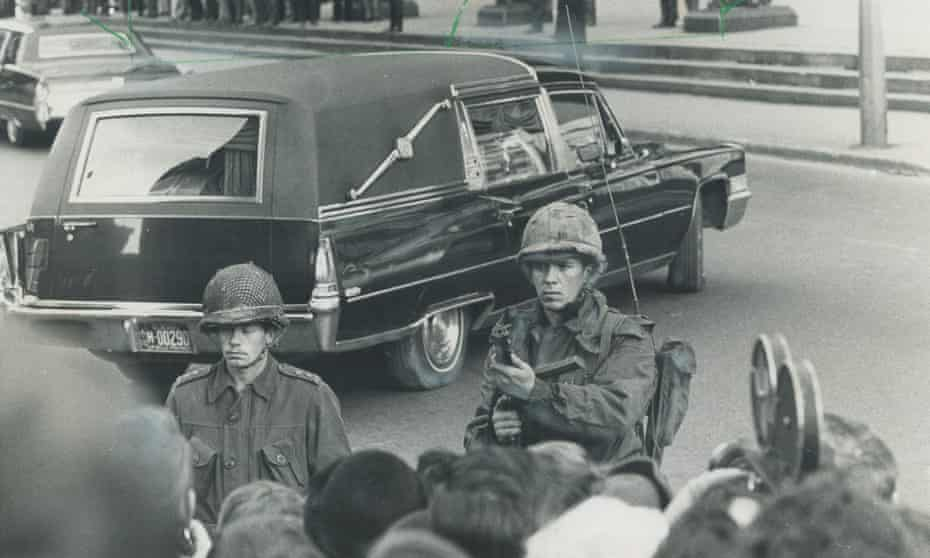 Canadian soldiers guard the funeral cortege of Quebec's deputy prime minister, Pierre Laporte, who was murdered by FLQ separatists.