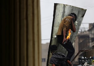 A demonstrator holds a Molotov cocktail during anti-government protests in Baghdad.